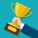 Business Hand Holding Trophy - GraphicRiver Item for Sale