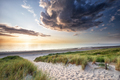 sunset light over sand dunes by sea - PhotoDune Item for Sale