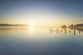 Wooden pier or jetty remains and lake at sunrise. Torre del lago Puccini Versilia Tuscany, Italy - PhotoDune Item for Sale
