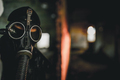 Man wearing protective gas mask for covid,covid19 and nuclear  prevention. Film look and dark tones. - PhotoDune Item for Sale