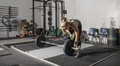 Young strong woman loading weights onto a barbell in a gym. - PhotoDune Item for Sale