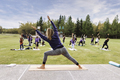 Outdoor Yoga classes. Group of adults attending yoga classes in the park. - PhotoDune Item for Sale