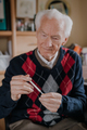 Old Man Holding Thermometer in hand Covid-19 - PhotoDune Item for Sale