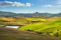 Volterra panorama, rolling hills, green fields and small lake. Tuscany, Italy - PhotoDune Item for Sale