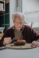 Single senior eats dinner at home - PhotoDune Item for Sale