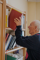 Elderly man reading book at home - PhotoDune Item for Sale