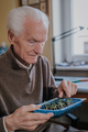 Senior observes sprouts of green vegetables - PhotoDune Item for Sale