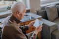 Positive Senior using Digital Tablet - PhotoDune Item for Sale
