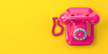 Vintage pink telephone on yellow background. - PhotoDune Item for Sale
