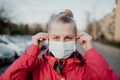 Portrait of Woman Wearing Protective Mask Against Covid-19 Outdoors - PhotoDune Item for Sale