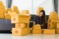 Portrait beautiful young asian woman with container cardboard parcel box - PhotoDune Item for Sale