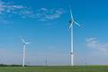 Modern wind energy turbines in a cornfield - PhotoDune Item for Sale