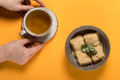 Sweet dessert with tea on a colored background - PhotoDune Item for Sale