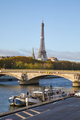 Eiffel tower and Seine river with boats in a sunny day in Paris, France - PhotoDune Item for Sale