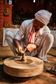 Indian potter at work, Shilpagram, Udaipur, Rajasthan, India - PhotoDune Item for Sale