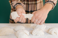 Woman cuts pieces of dough to prepare her handmade bread, homemade cooking. - PhotoDune Item for Sale