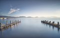 Two Wooden pier or jetty at sunset and sky reflection on water. Versilia Tuscany, Italy - PhotoDune Item for Sale