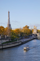 Seine river view with boat, Eiffel tower and Alexander III bridge in a sunny autumn day in Paris - PhotoDune Item for Sale