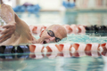 Close up shot of man in his mid 70s swimming laps in a pool. - PhotoDune Item for Sale