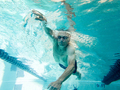 Athletic senior man in his mid 70s swimming laps, view from underwater. - PhotoDune Item for Sale