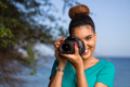 African American woman  photographer taking outdoor photos -  Black people - PhotoDune Item for Sale