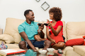 Black African American couple drinking wine in the living room - PhotoDune Item for Sale