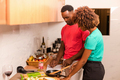 Black African American couple preparing food in the kitchen - PhotoDune Item for Sale