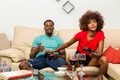 Black African American couple having fun playing video games - PhotoDune Item for Sale