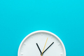 Photo of Part of White Wall Clock Over Turquiose Blue Background With Copy Space - PhotoDune Item for Sale