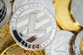 Close-Up of Litecoin Physical Coin On Stack of Many Other Cryptocurrencies - PhotoDune Item for Sale