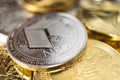 Close-Up of Neo Physical Coin On Stack of Many Other Cryptocurrencies - PhotoDune Item for Sale