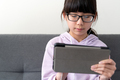 Female teenager using digital tablet - PhotoDune Item for Sale