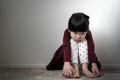 Lonely sad little girl holding her knees - PhotoDune Item for Sale