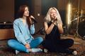 Two girlfriends sing in karaoke sitting on floor - PhotoDune Item for Sale