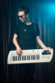 Trendy young man playing on an electronic keyboard - PhotoDune Item for Sale