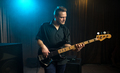 Male guitarist playing an electric bass guitar - PhotoDune Item for Sale