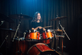 Woman playing drums during a live performance - PhotoDune Item for Sale