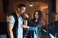 Woman coaching a male vocalist or singer - PhotoDune Item for Sale