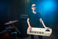 Man in sunglasses playing on electronic keyboard - PhotoDune Item for Sale