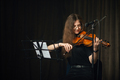 Classical musician playing the violin on stage - PhotoDune Item for Sale