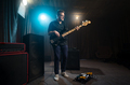 Musician playing an electric bass guitar on stage - PhotoDune Item for Sale
