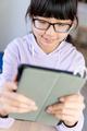 Female teenager using digital tablet for live chat - PhotoDune Item for Sale