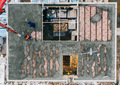 Aerial view of construction workers pouring a wet concrete at floor - PhotoDune Item for Sale