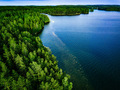 Aerial view of blue lake and green forest in Finland. - PhotoDune Item for Sale
