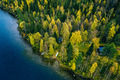 Aerial view of cottage in autumn colors forest by the blue lake in rural  Finland - PhotoDune Item for Sale
