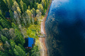 Aerial top view of log cabin or cottage with sauna in spring forest by the lake in Finland - PhotoDune Item for Sale