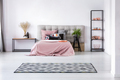 Trendy black and white rug on white floor of cozy bedroom interior - PhotoDune Item for Sale