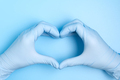 Doctor hands with gloves making heart shape - PhotoDune Item for Sale