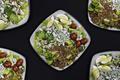 Fresh vegetable salad. Assorted vegetable salad on black background. - PhotoDune Item for Sale