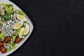 Organic homemade salad. Assorted vegetable salad on black background. - PhotoDune Item for Sale